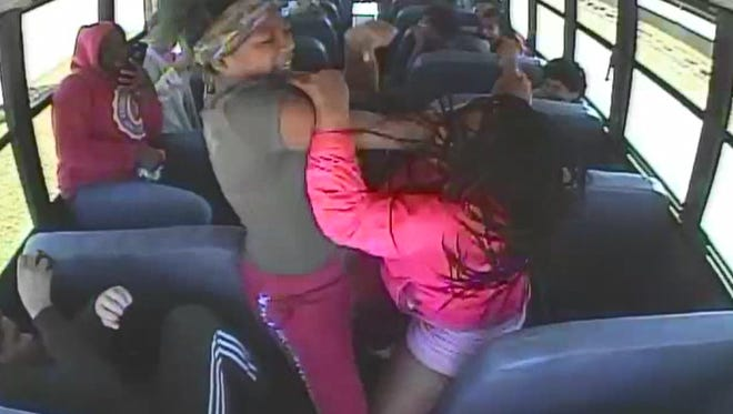 Video surveillance footage shows two Nicolet High School students fighting on a school bus on April 25. One of the girls called her mother, Magan Gumbus, who allegedly chased after the bus and hit the door and windows with a hammer.