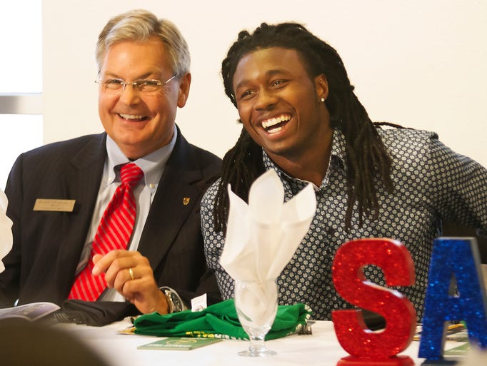 Fort Myers Mayor Randy Henderson, left, and Sammy Watkins attend the Southwest Florida Sports Banquet and Ball on Friday at the City Pier in downtown Fort Myers. Henderson presented Watkins with the key to the city.