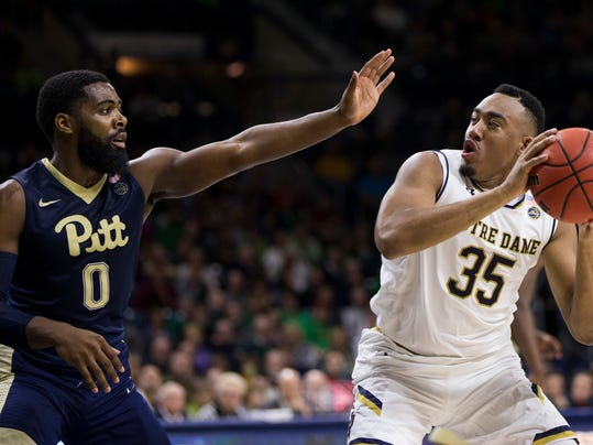 Notre Dame's Bonzie Colson (35) gets pressure from Pittsburgh's Jared Wilson-Frame (0) during the second half of an NCAA college basketball game Wednesday, Feb. 28, 2018, in South Bend, Ind. Notre Dame won 73-56. (AP Photo/Robert Franklin)