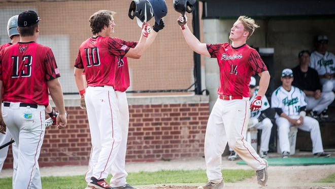 Wapahani's Grant Thompson celebrates with his team after scoring a home run that gained Wapahani 3 runs Monday evening at Yorktown High School. Wapahani won the game 8-4.