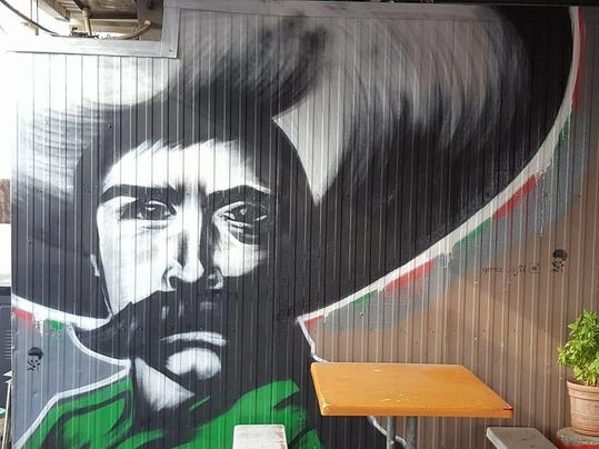 Visalia muralist paints the town for Emiliano zapata mural