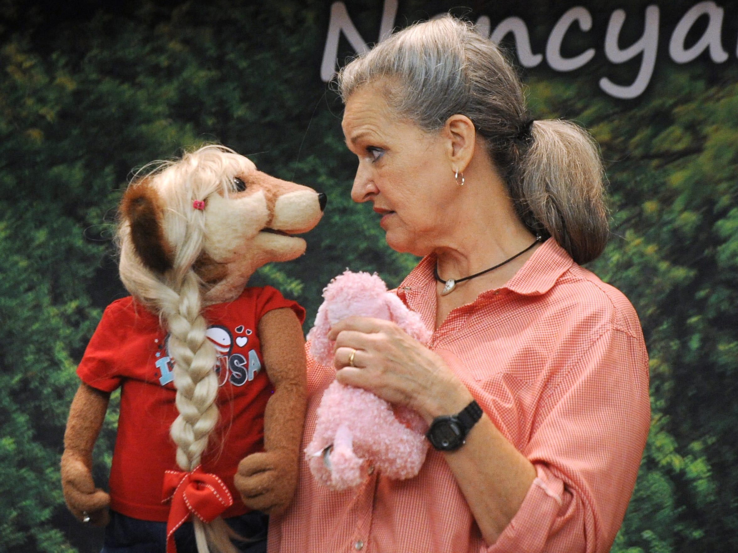 Nancy Worcester presents her ventriloquist show at the main branch of the Abilene Public Library as part of a Young Audiences program in 2015.