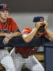 Mississippi pitcher Will Stokes (17), left, and Mississippi