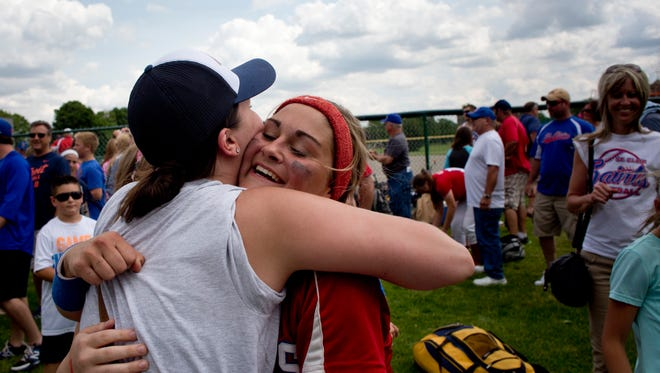 St. Clair senior Avary Humes gets a hug from her sister Karly Humes, 19, after being Center Line in a quarterfinal softball game Tuesday, June 9, 2015 at Wayne State University in Detroit. St. Clair beat Center Line 17-0 in four innings, with six home runs.