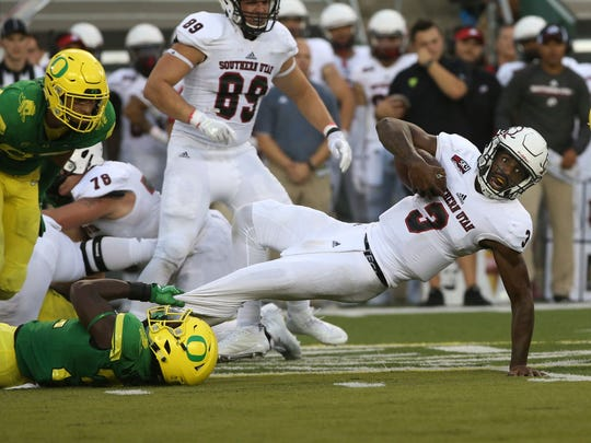 Oregon's LaMar Winston Jr., left, pulls down Southern