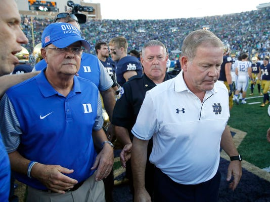 Notre Dame head coach Brian Kelly, right, walks away from Duke head coach David Cutcliffe after their handshake after an NCAA college football game Saturday, Sept. 24, 2016, in South Bend, Ind. (AP Photo/Charles Rex Arbogast)