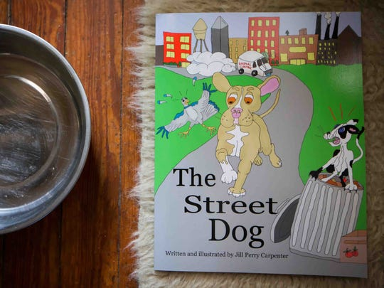 """Author Jill Carpenter of Wilmington wrote a series of books about a street dog named Walt called """"The Street Dog""""."""
