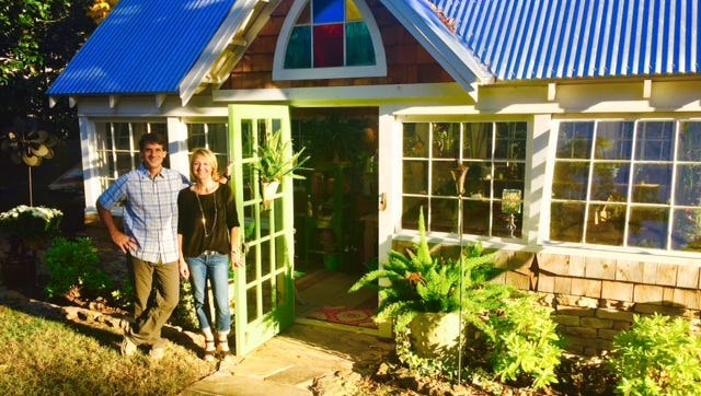 Chris and Leslie Coleman outside the greenhouse he built.