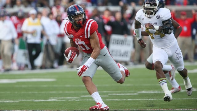 Ole Miss' Evan Engram (17) hauls in a pass in the first half. Mississippi State played Ole Miss in a college football game on Saturday, Nov. 29, 2014 at Vaught-Hemingway  Stadium in Oxford, Miss. (Photo by Keith Warren)