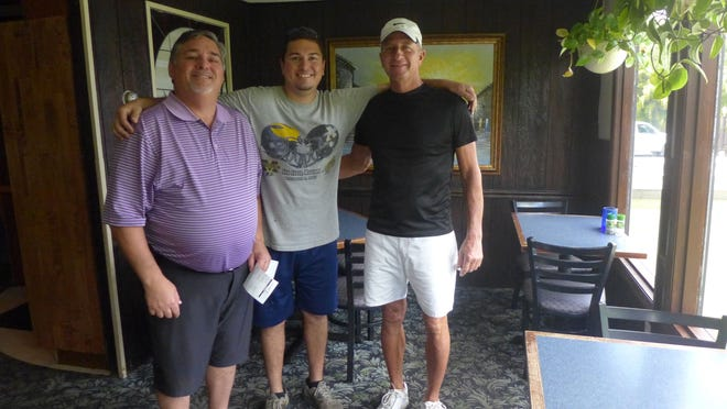 From left: Charley's Boat House general manager Michael Stanton, his son and waiter Chad Stanton and longtime chef/kitchen manager Tim Henkel stop for a picture in Charley's dining room.