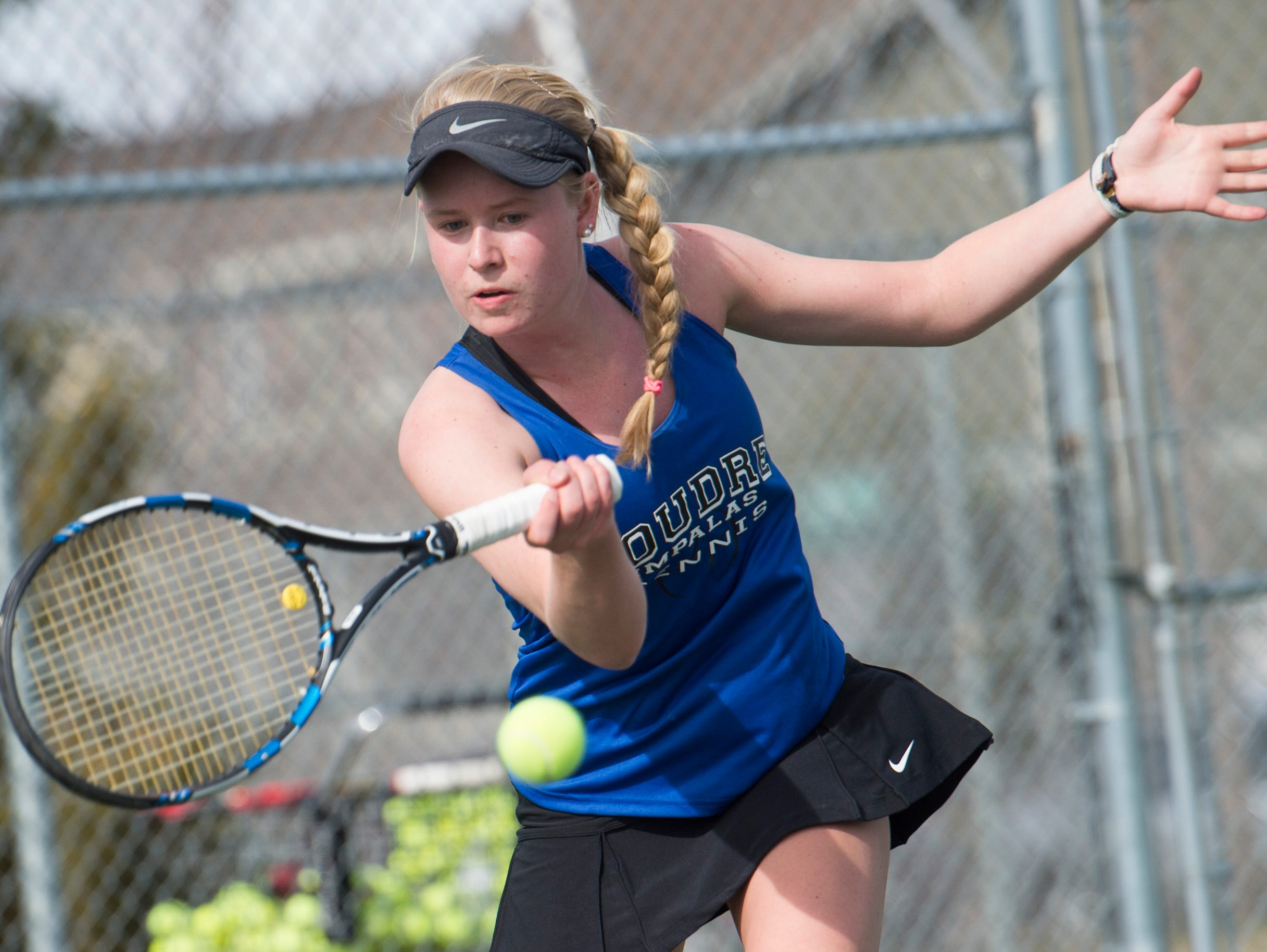 Ky Ecton of Poudre returns the ball to Shawnea Pagat of Fossil Ridge High School during a tennis match Wednesday, April 6, 2016.