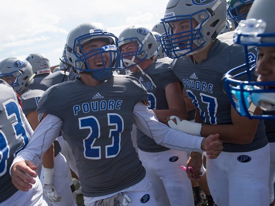 The Poudre High School sideline erupts after an interception