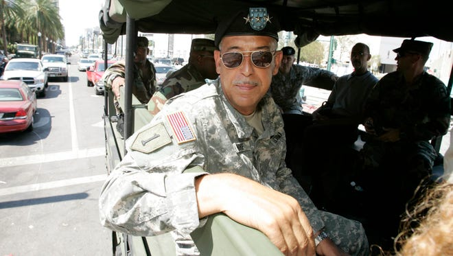 Army Lieutenant General Russell Honore boards a military carrier as he goes to meetings with city and military officials in New Orleans in 2005.