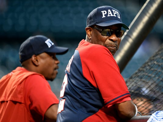 Washington Nationals manager Dusty Baker, right, and his team wear baseball caps in honor of New York City service personnel during batting practice before a baseball game against the New York Mets, Sunday, Sept. 4, 2016, in New York. Baker wore a cap in honor of the Port Authority Police Department. (AP Photo/Kathy Kmonicek)