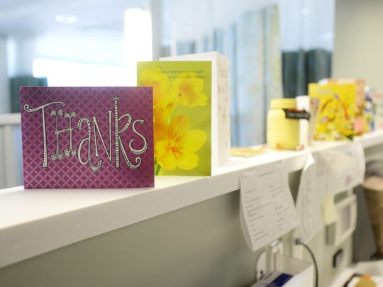 Thank-you cards line a divider in the Dr. Nick & Nancy Sarap Cancer Care Center at Genesis Hospital.
