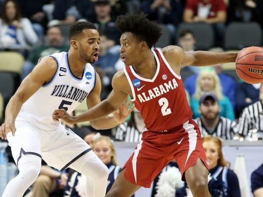 Mar 17, 2018; Pittsburgh, PA, USA; Alabama Crimson Tide guard Collin Sexton (2) handles the ball against Villanova Wildcats guard Phil Booth (5) during the first half in the second round of the 2018 NCAA Tournament at PPG Paints Arena. Mandatory Credit: Charles LeClaire-USA TODAY Sports