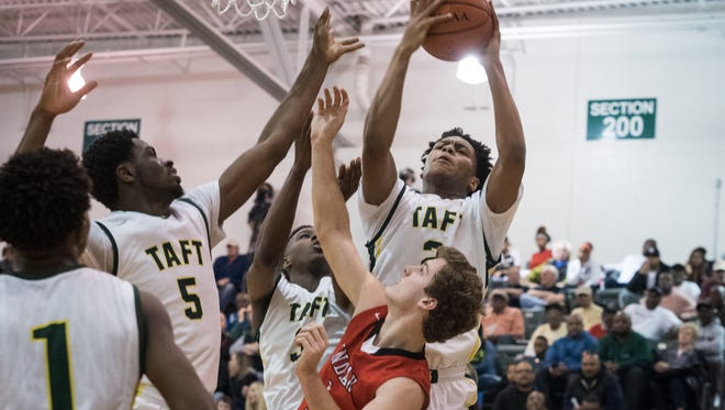Taft takes the ball away from Indian Hill at the Indian Hill vs. Taft game at Mason on Saturday Feb. 27,  2016. Taft won the game with a final score of 53-42.