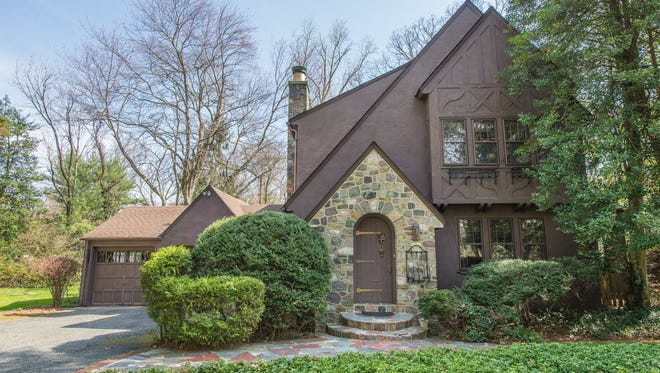 This Tudor-style home in Mountain Lakes is an authentic Belhall design