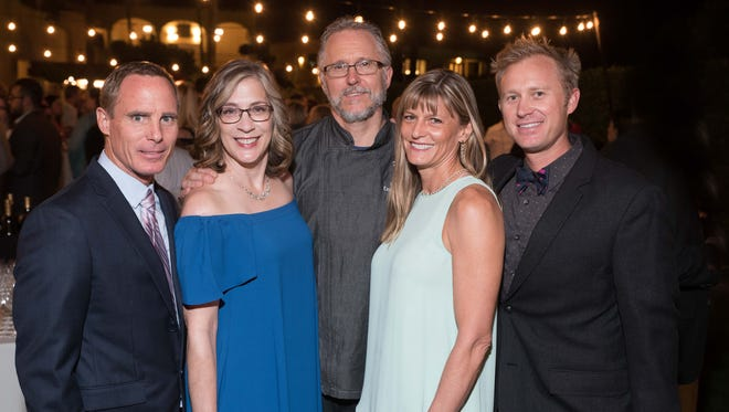 Mixing and mingling at the Pendleton Chef Auction reception at the Miramonte Resort & Spa are (from left) Sean Roberts, Pendleton board president; Karen Pendleton; Thunderbird Country Club Executive Chef Chris Olson; Gina Garside, board treasurer; and Troy Kudlac, board member.
