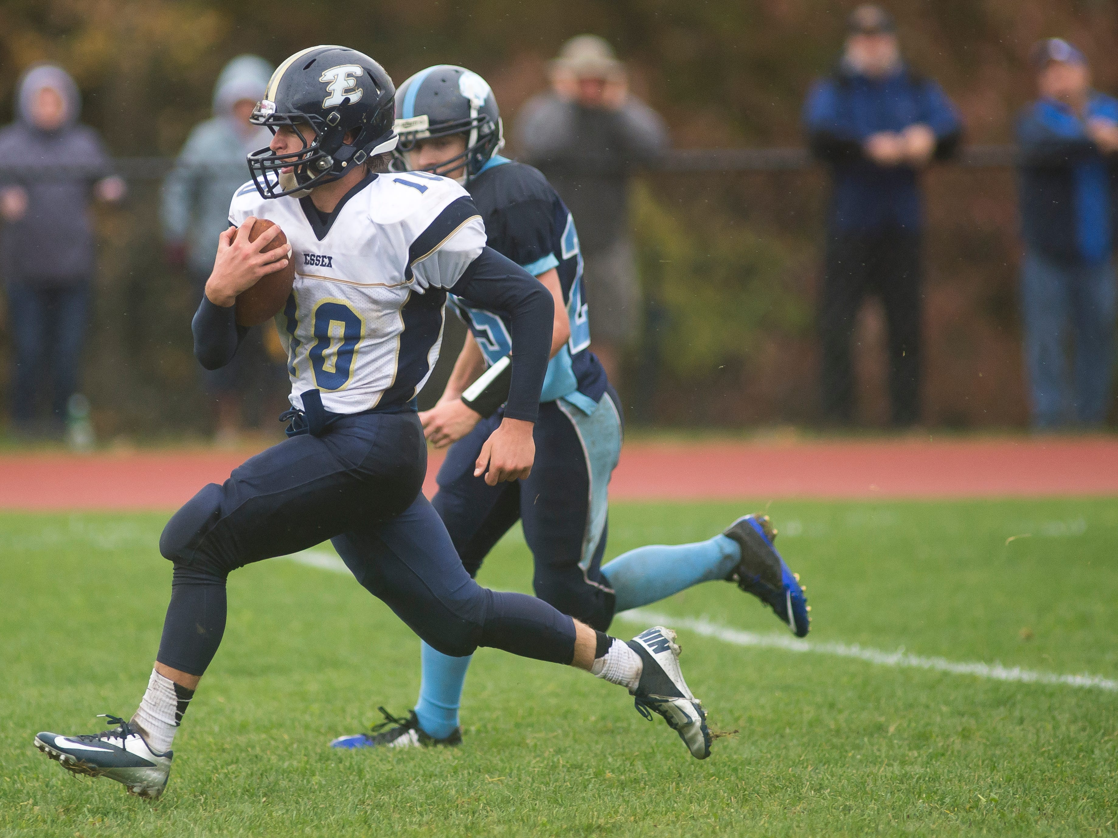 Essex High School's #10 Brendan Gleason turns on the speed into the end zone for the touchdown Saturday at MMU.