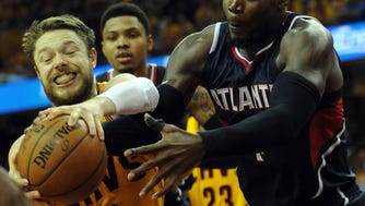 Cleveland Cavaliers guard Matthew Dellavedova (8) fights with Atlanta Hawks forward Paul Millsap (4) for the ball during the fourth quarter in game three of the Eastern Conference Finals of the NBA Playoffs at Quicken Loans Arena.