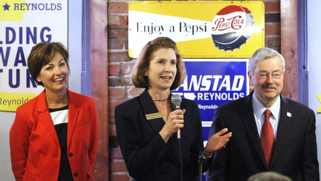 State auditor Mary Mosiman speaks during a rally for Republican candidates at Smokey Row in Oskaloosa on Wednesday, June 4, 2014.  With her are Lt. Gov. Kim Reynolds and Gov. Terry Branstad.