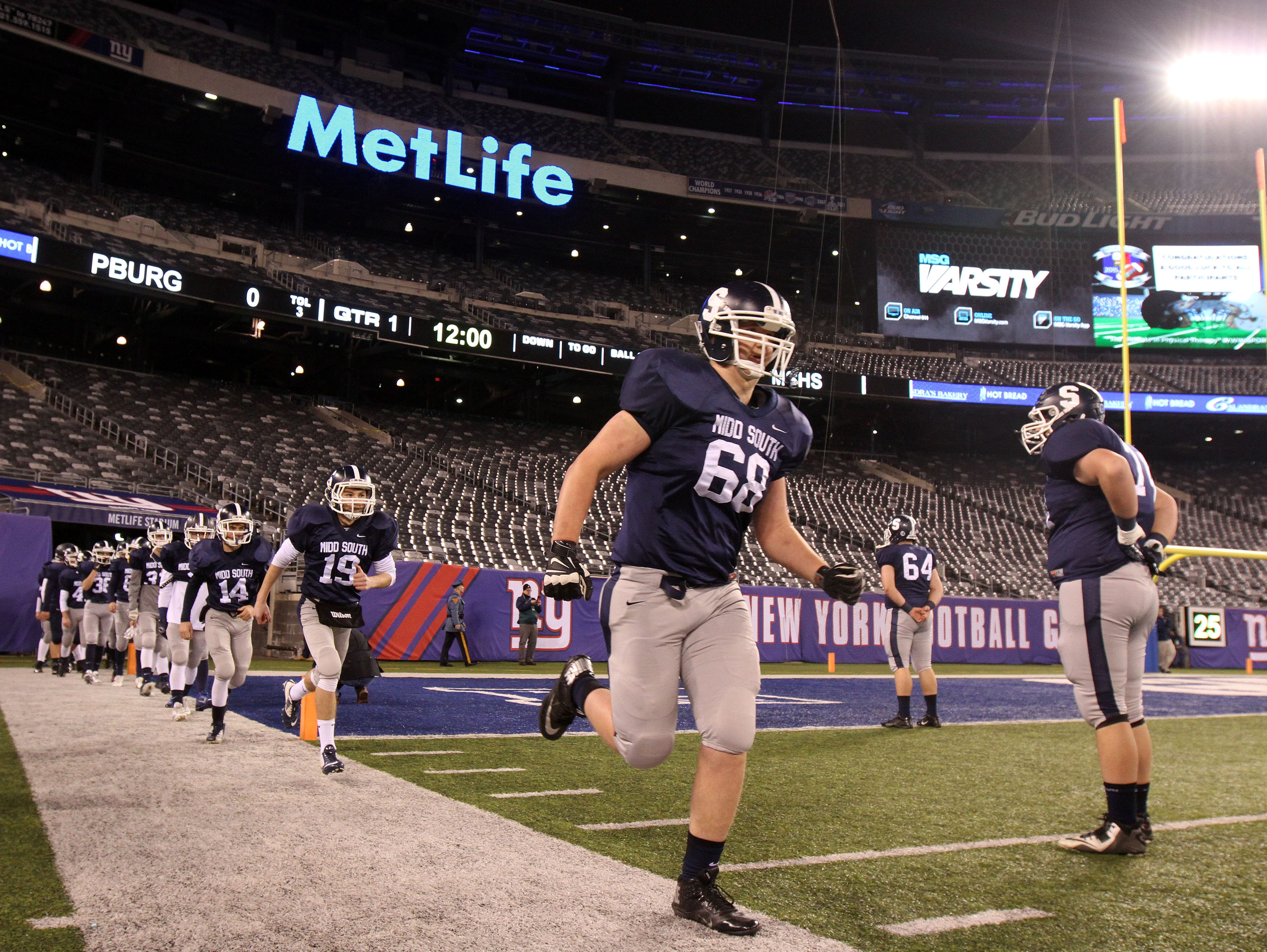 Middletown South warms up before the Phillipsburg High School vs Middletown South High School during the North 2 Group IV game of the 2015 NJSIAA/MetLife Stadium High School Football Championships at MetLife Stadium in East Rutherford, NJ Saturday December 5, 2015.