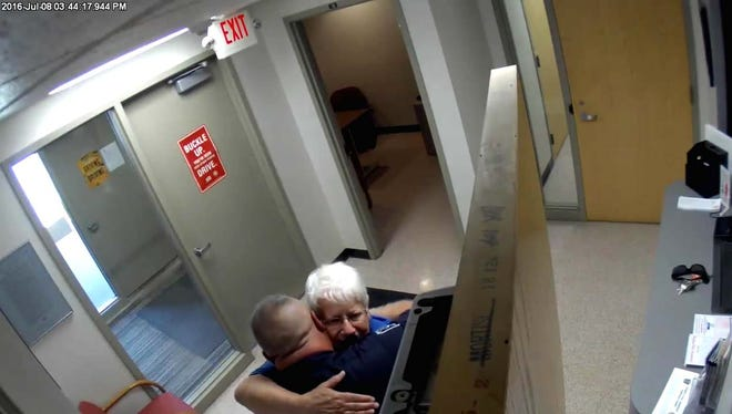 An unknown woman walked into the Brighton Police Department on July 8 and asked to hug an officer. Officer Don Bishop happily accepted.