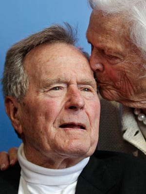 Former president George H.W. Bush receives a kiss from his wife, Barbara, as they arrive for the premiere of an HBO documentary on his life June 12 near the family compound in Kennebunkport, Maine.