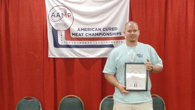 Strick's Specialty Meats recently received national recognition for its smoked and cooked sausage.Pictured is ownerDustin Strickland.