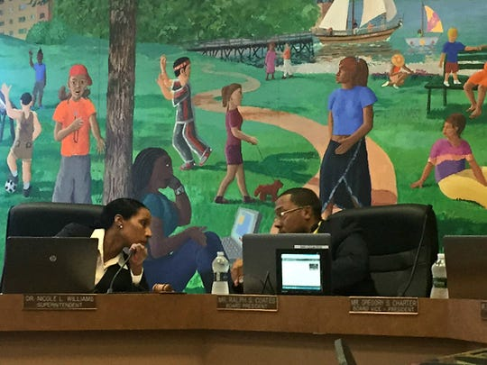School Superintendent Nicole Williams, left, speaks