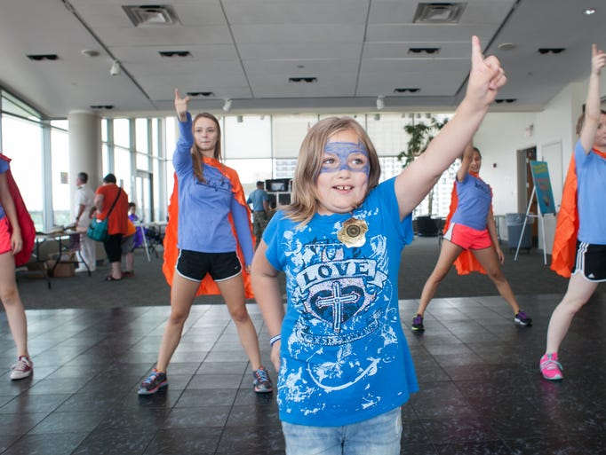 Madison Kern, age 8, learns a dance routine with the students from Sacred Heart School for the Arts during 'Discover Your Superpower' put on by The Global Game Changers Children's Education Initiative and the Muhammad Ali Center.  Aug., 24, 2014