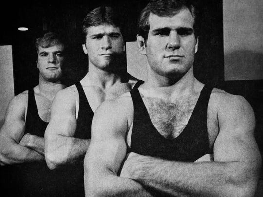 Lou Banach, left, Steve Banach, center, and Ed Banach, right, shown during their wrestling days at Iowa in 1982.