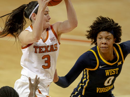 Naomi Davenport (o) defends Texas guard Danni Williams (3) as West Virginia faced the Longhorns Jan. 28. (Nick WagnerAustin American-Statesman via AP)