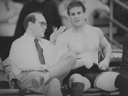 In this undated photo, Iowa wrestling coach Dan Gable confers with Mark Reiland.