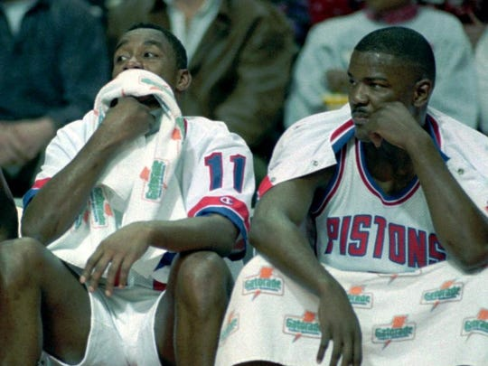 Detroit Pistons' guards Isiah Thomas, left, and Joe Dumars sit on the bench midway through the first quarter watching the Utah Jazz increase their lead Monday night, Jan. 17, 1994, at the Palace of Auburn Hills, Mich. The Jazz handed the Pistons their 13th straight loss by defeating them 109-94.