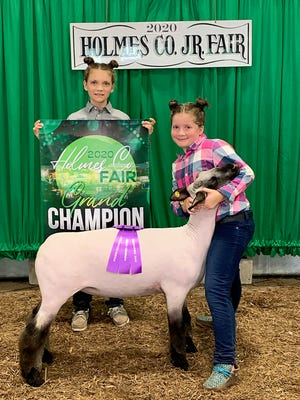 Kaitlyn Klink with sister Lily had the Grand Champion Holmes County Born and Raised Market Lamb.