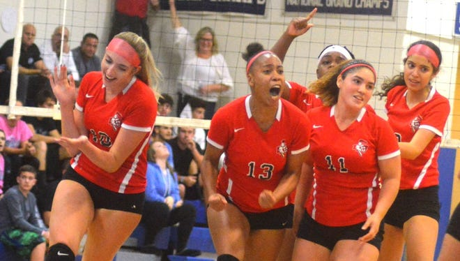 Elmwood Park's girls volleyball team celebrating a point during the NJIC tournament title match against Wood-Ridge.