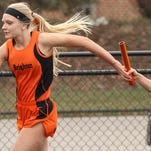 Brighton's Shannon McGrath (left) was the Lakes Conference champion in the 200-meter dash on Saturday, helping Brighton win the Lakes Conference title as a team.