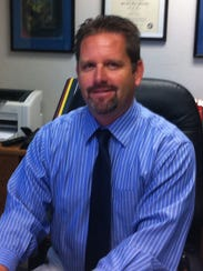 Brian Mercer will serve as the director of high school