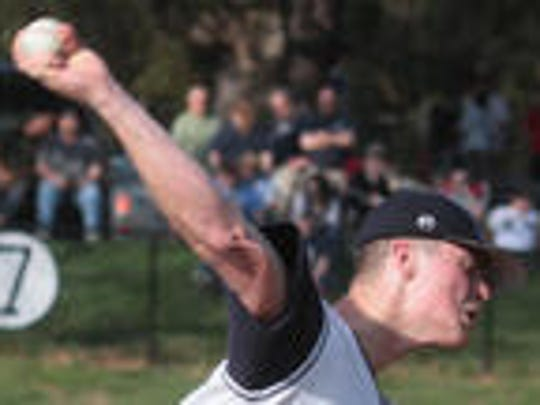 In this April 8, 2010, photo,  Robbie Aviles of Suffern delivers a pitch against Tappan Zee. Twelve  pitches into Aviles' final high school game, he tore his UCL and would require dreaded Tommy John surgery.