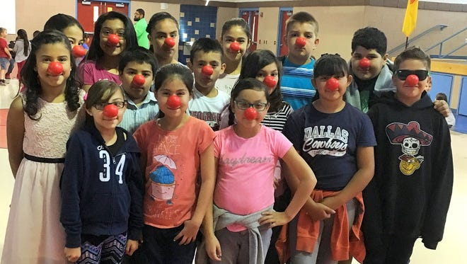 lub HERO students at Ruben S. Torres Elementary School are ready for Thursday's national Red Nose Day. Club HERO will be sponsoring a one-day canned food drive as part of Thursday's celebration. Red Nose Day is a special day for Americans to come together to have fun and make a difference for kids. The day's events will culminate in a two-hour live prime-time TV special on NBC. Funds raised go to the Red Nose Day Fund which distributes the money through programs to keep children and young people safe, healthy and educated. Every class at RST has pledged to bring a certain amount of canned food which will be donated to Helping Hand, Inc. food pantry in Deming.