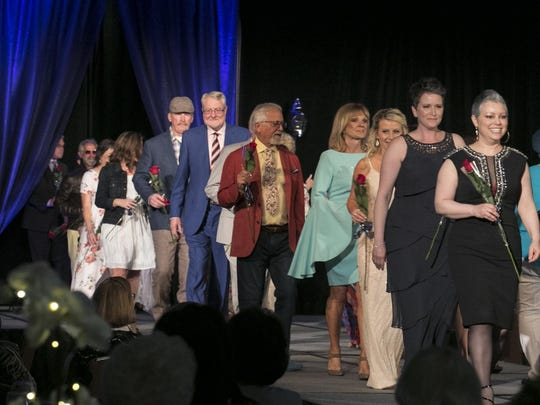 Walking down the runway, the cancer survivors drew attention to the need for more cancer research.
