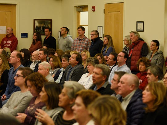 A crowd looks on during a Mahwah Township Council meeting
