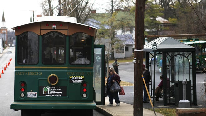 Patrons board a trolley on Lewis St. in Staunton on Wednesday, Dec. 12, 2012.