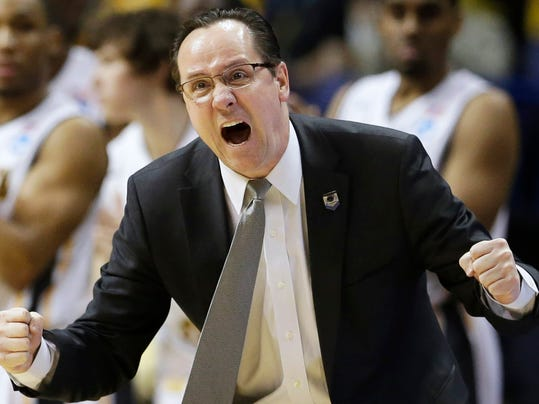 FILE - In this March 23, 2014 file photo, Wichita State head coach Gregg Marshall encourages his team during the second half of a third-round game against Kentucky at the NCAA college basketball tournament in St. Louis. Marshall, whose Wichita State team was the first to reach the NCAA tournament undefeated in 33 years, has been selected The Associated Press' coach of the year, Thursday, April 3, 2014. (AP Photo/Charlie Riedel, File)