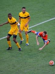 FC Cincinnati midfielder Corben Bone (19) takes a fall