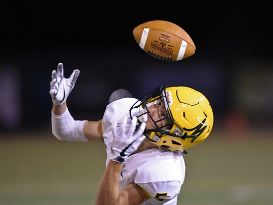Manogue's Vai Kaho looks to makes a catch against Damonte Ranch in Friday's game at Damonte Ranch.