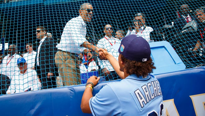 Rays pitcher Chris Archer shakes hands with President Barack Obama before the team's game in Cuba on Tuesday.