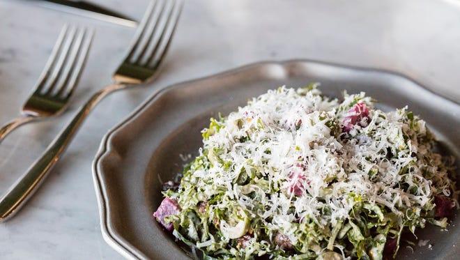 Butchertown Grocery's kale salad: beets, olives, black currants, parmesan, citrus.
